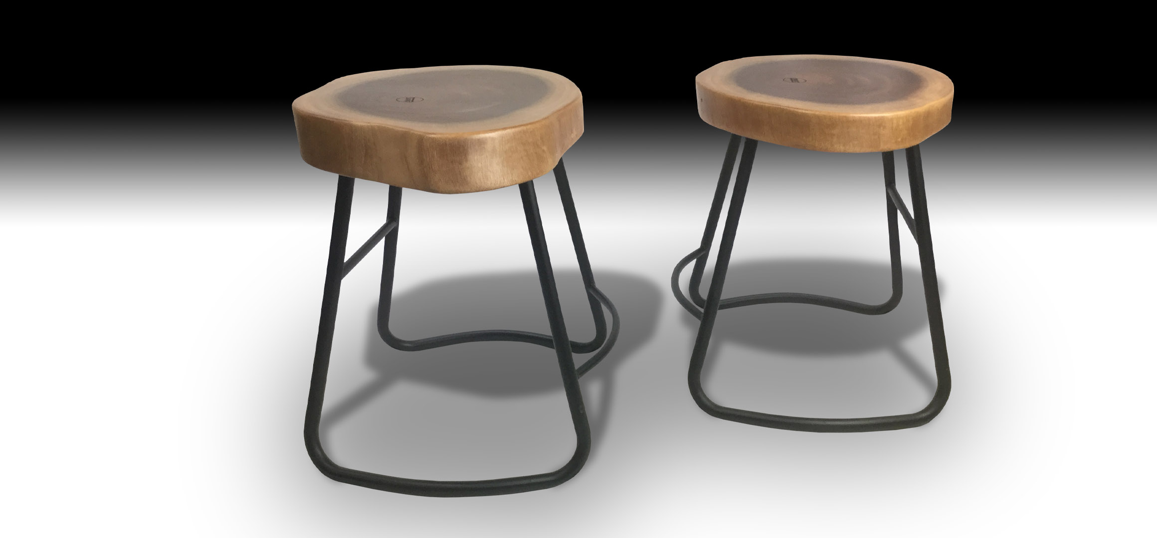 Two Julian Suar wood stools