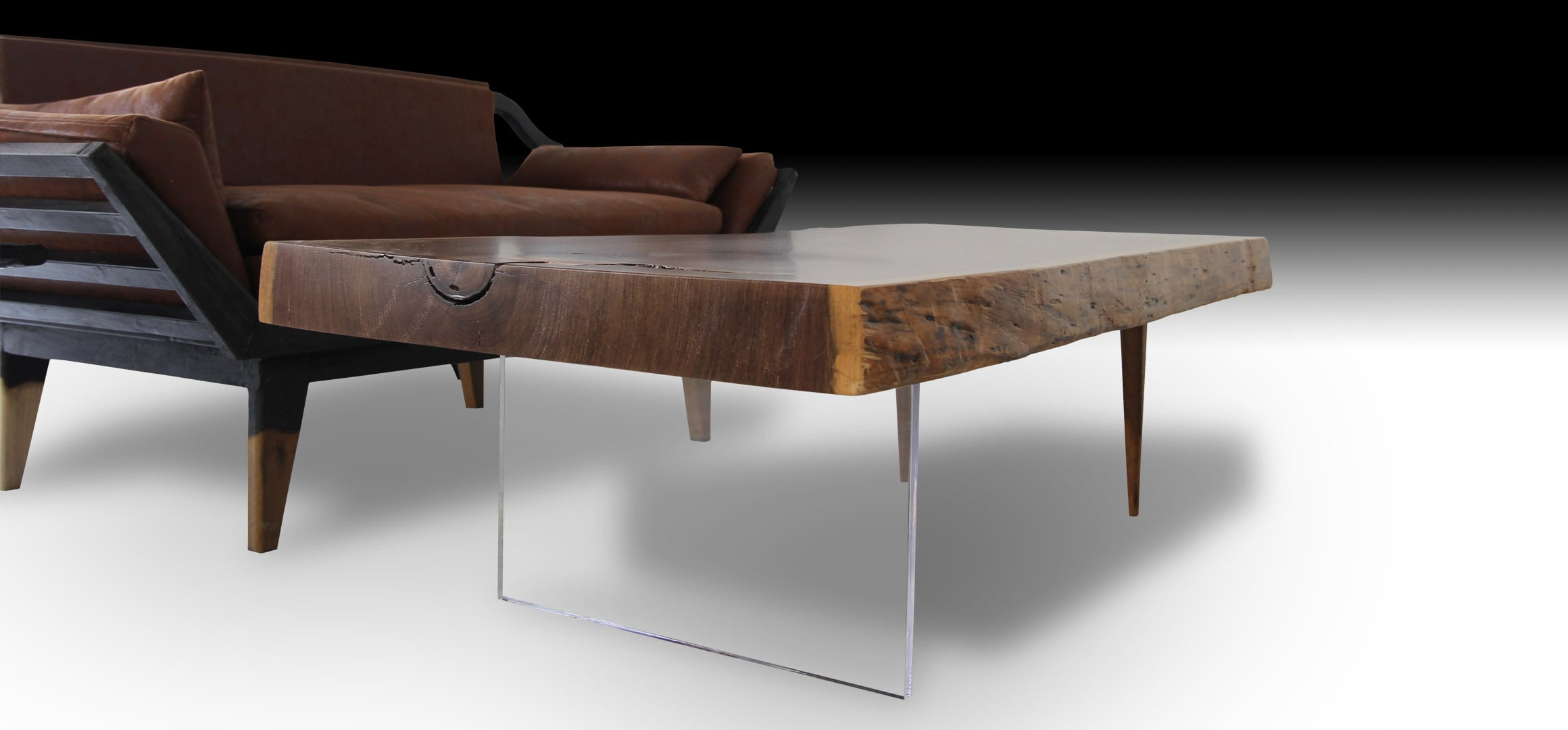 Animal live edge walnut wood coffee table next to a wooden sofa
