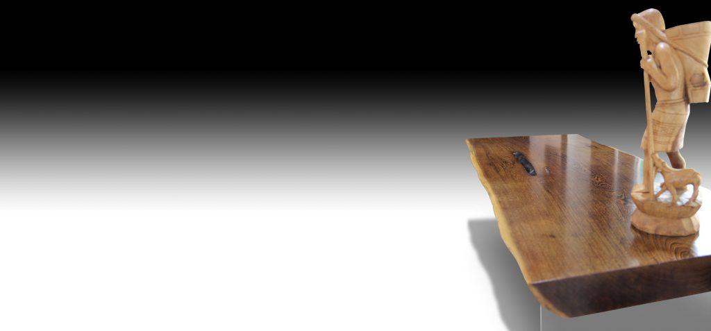 Mandarin live edge Walnut wood dining table with wooden figurine