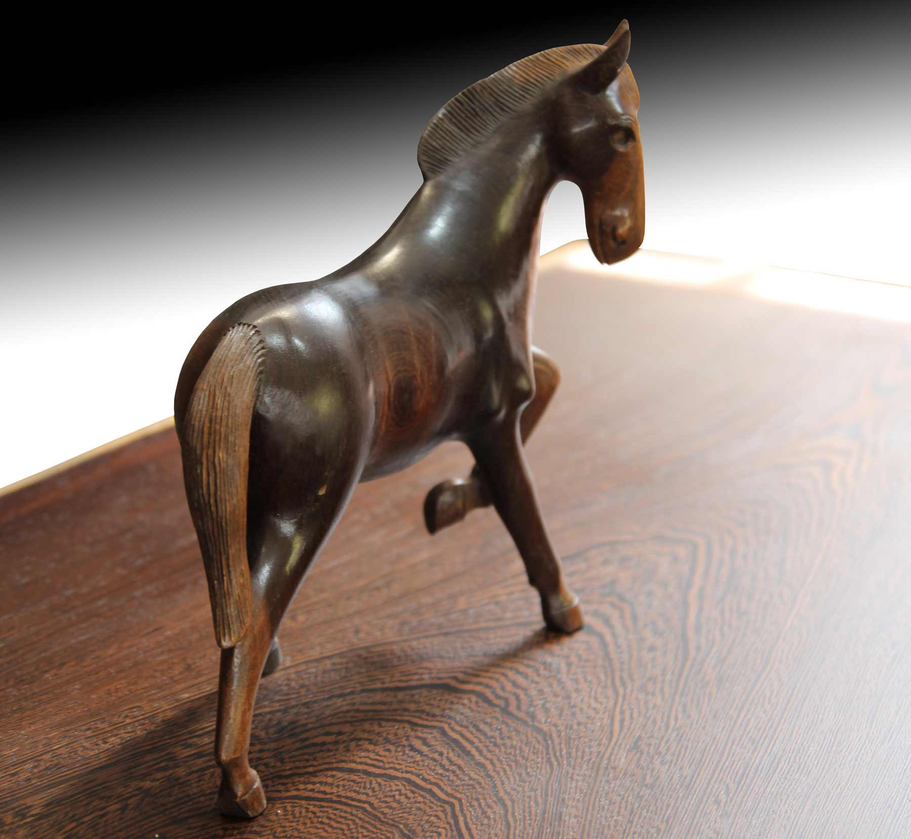 Wooden horse fugurine on live edge Suar wood table