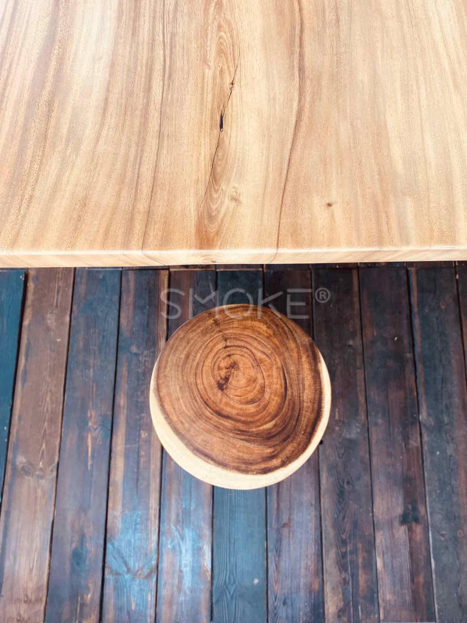 Suar wood stool on panel floor